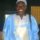 Rom Wandera wearing traditional dress.