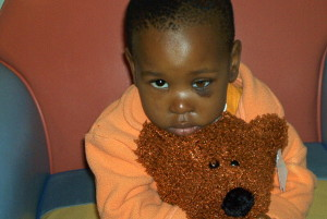 Rati takes comfort in her special bear during chemotherapy treatment.