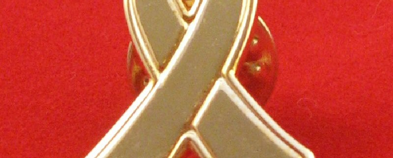 Metal Gold Ribbon Lapel Pin.