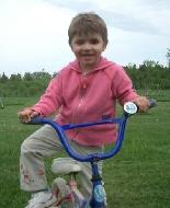 Daisy riding her bike