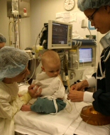 A young child prepares for a general anaesthetic.