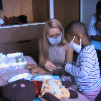 Rati plays doctor wiht the help of a child life specialist in Toronto.