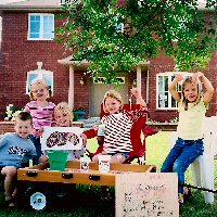 A group of children hold a fundraising stall.