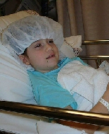 A young girl awaits surgery.