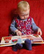 A child explores a picture book.