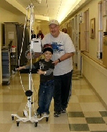 Father and son take a walk during chemotherapy.