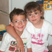 A brother and sister both affected by eye cancer.