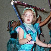 A young girl dances like a princess.