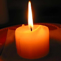 A single candle flame burns bright.
