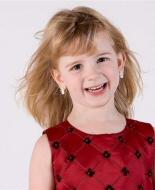 A young girl with heritable retinoblastoma.