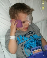 A child relaxes during plaque therapy.