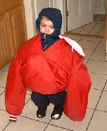 A young boy almost drowns in an adult's coat.