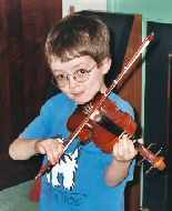 A young boy plays his violin.
