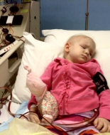 A young girl has blood stem cells harvested before transplant.