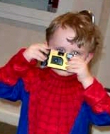 Playing with his own camera, this child's cancer is clearly visible in his eye