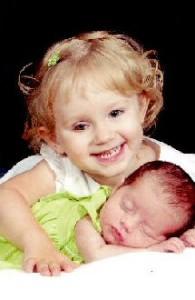 Libby hugd her baby sister, Ella.