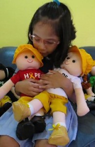 Chariabella hugs her cancerr hope dolls.