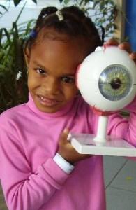 Sera holds up a model eye.