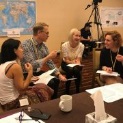 Doctors and scientists compare notes in a breakout session during One Rb World