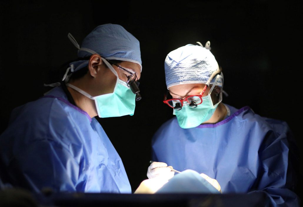 Two surgeons work together in the operating room.