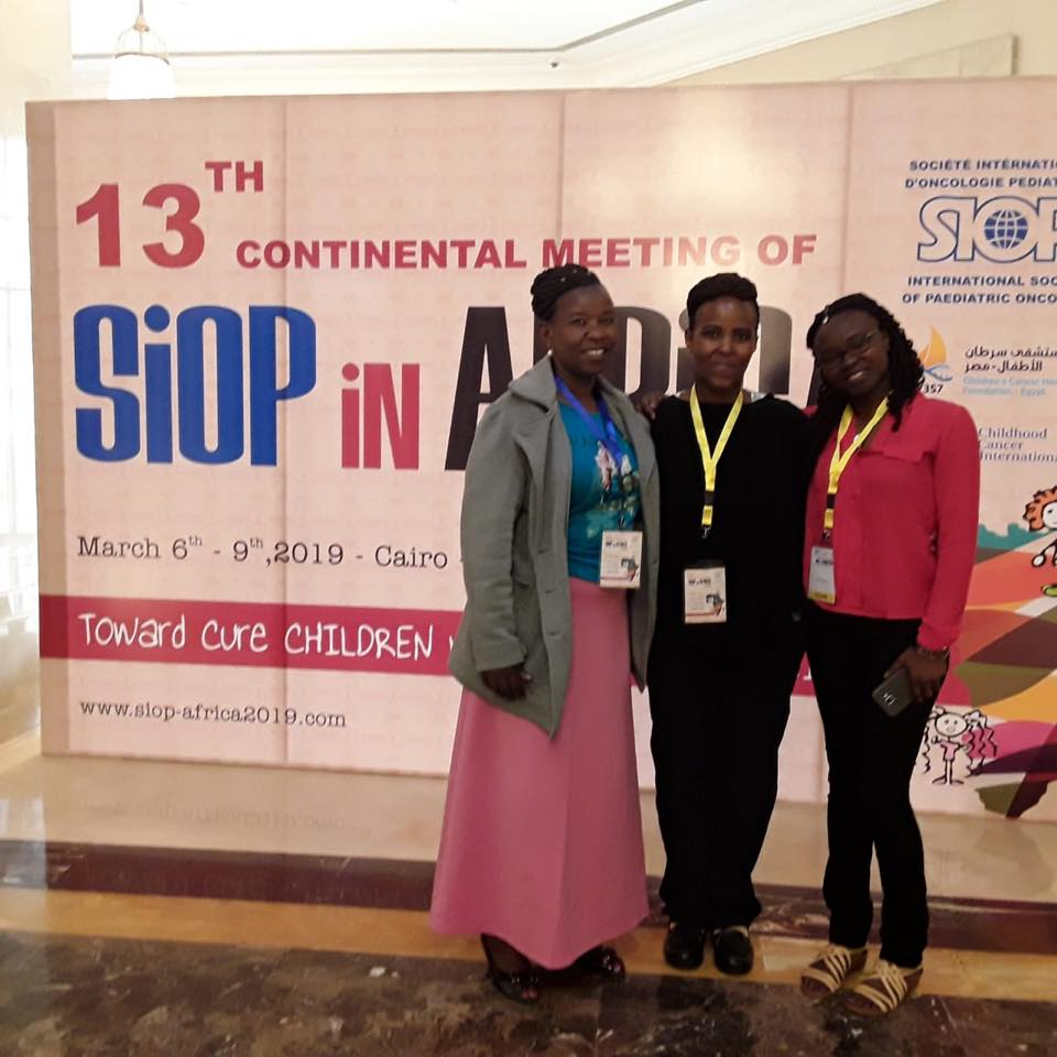 Jayne and Bella stand with a colleague next to the SIOP Africa Congress sign in Cairo, just days before they died.
