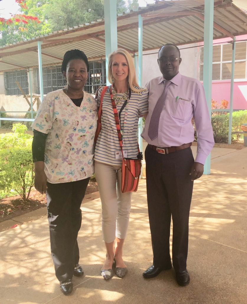 Jayne Morgan and Koech stand together outside the eye clinic.