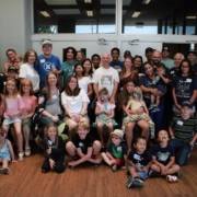 A large group photo, showing 40+ people of all ages.