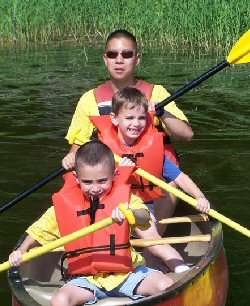 Children enjoy lake activities at Camp Sunshine