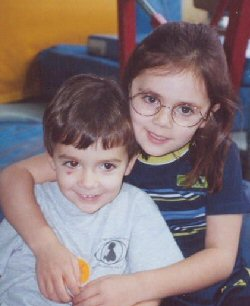 Brother and sister, young retinoblastoma survivors