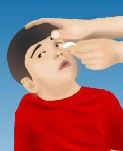 A child receives first aid to the eye.