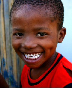 An African child smiles broadly.