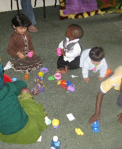 A group of young children play together while their parents participate in the 2010 KNRbS meeting.