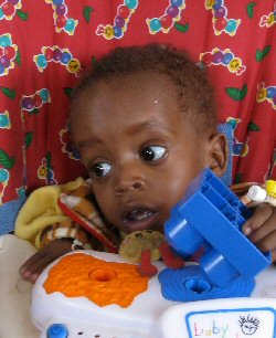 A child rests in hospital.