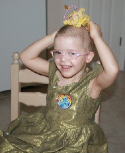 A young girl dressed in gold dances soon after chemotherapy.