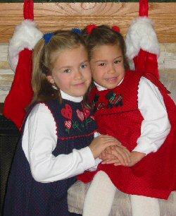 Two girls enjoy a sisterly hug.