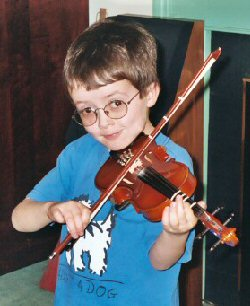 A young boy plays his violin.