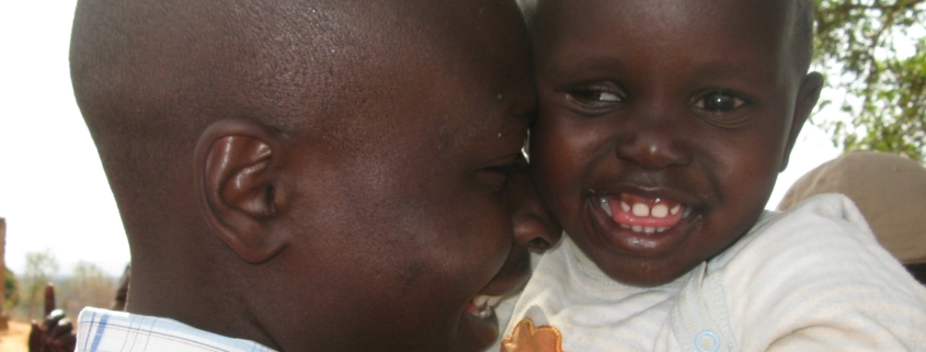 A young girl and her father share a smile