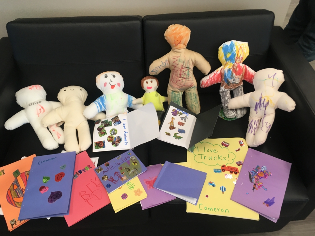 A collection of decorated cloth dolls and self published books