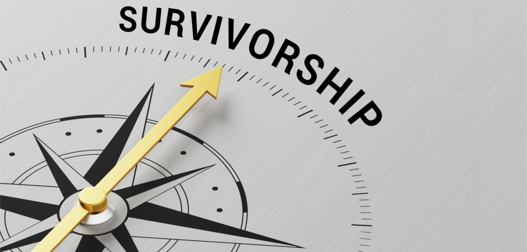 """The gold pin on a compass points to the word """"survivorship"""""""