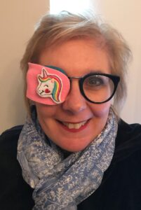 Sandra wears a patch over one lens of her glasses.