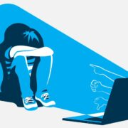 An abstract image of a child sitting on the floor, head on knees. The child sits in a shaft of blue light emanating from their laptop. Outlined hands emerge from the computer screen, pointing at the child.
