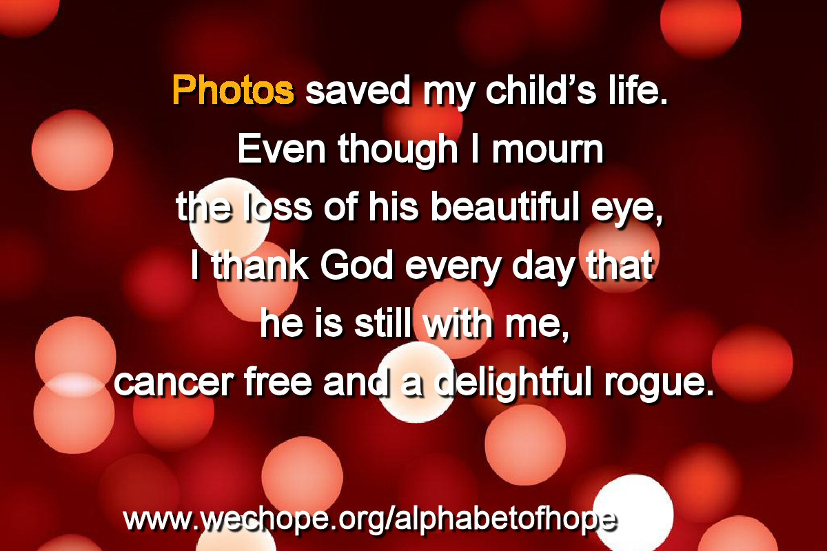 "The background image shows discs of light in varying intensities of white and red, on a deep red base. The first word of the text is highlighted in gold. Text reads: ""Photos saved my child's life. Even though I mourn the loss of his beautiful eye, I thank God every day that he is still with me, cancer free and a delightful rogue."""
