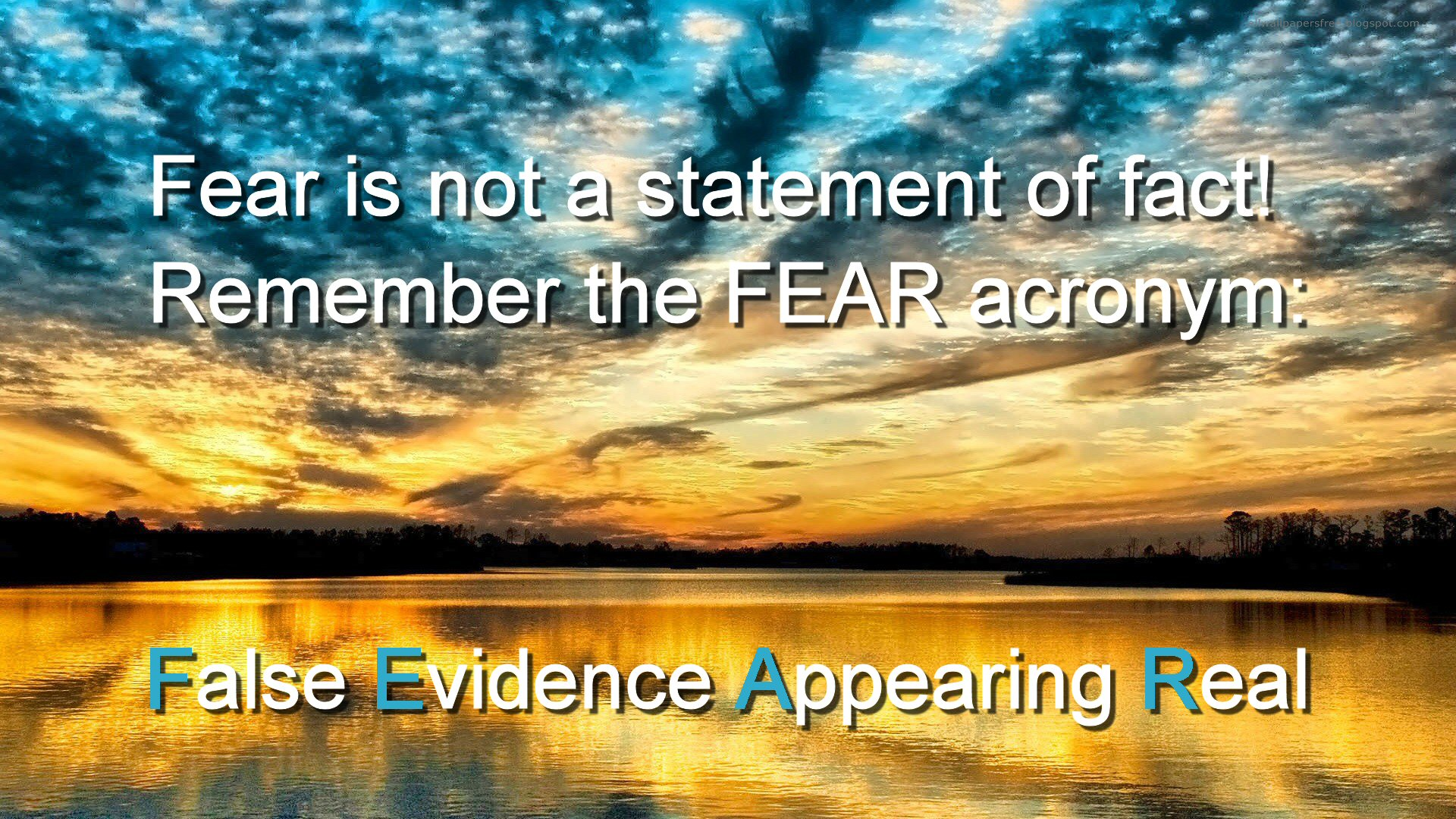 "Blue sky and sunlight are seen through bubbling lines of cloud about a sunlit horizon, reflecting yellow-gold and flecked with blue in the water below. Text set against the sky and water reads: ""Fear is not a statement of fact - Remember the FEAR acronym: False Evidence Appearing Real""."