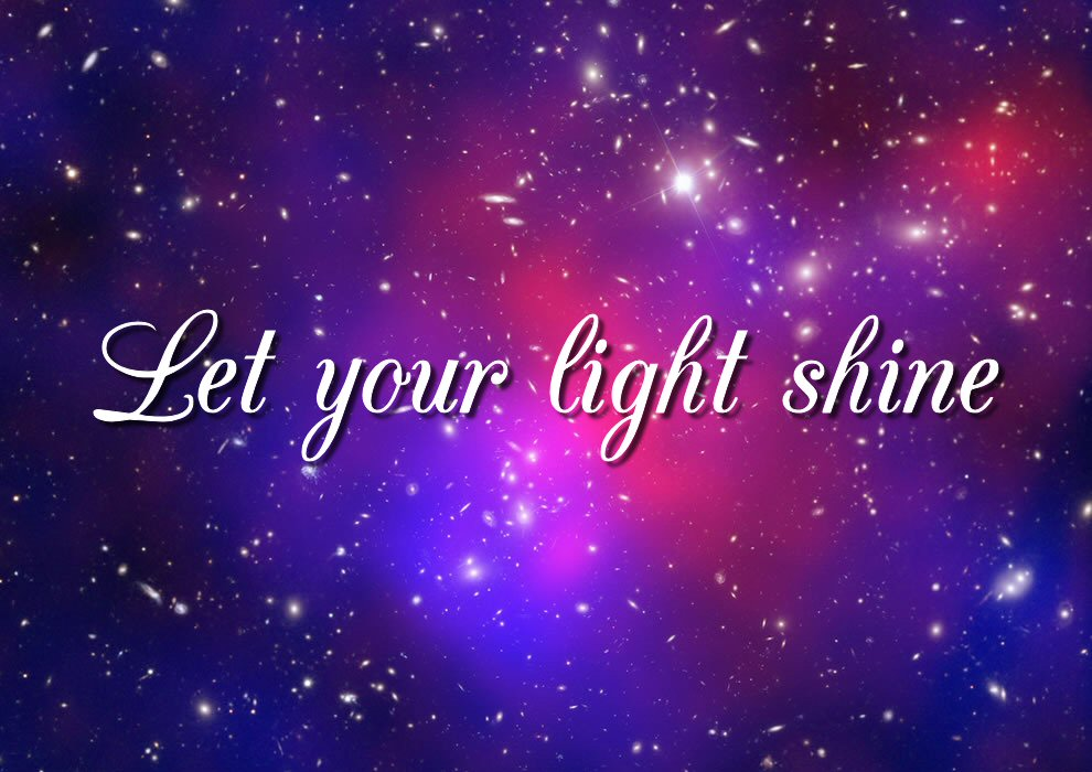 """Text reads """"Let your light shine"""", set against an image of Pandora's Cluster, a showing a red gassy heart merging into mauve and deep blue, flecked with the light of many galaxies."""