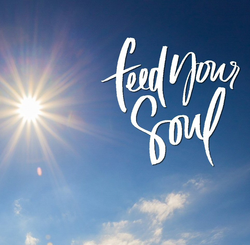 """Sunburst in a blue sky with small fluffy clouds. Text reads """"feed your soul."""""""